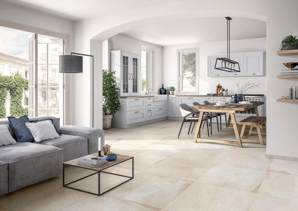 Große Landhausküche in Weiß mit Sitzplatz aus Holzmöbeln und Fliesen in Naturtönen von Villeroy & Boch